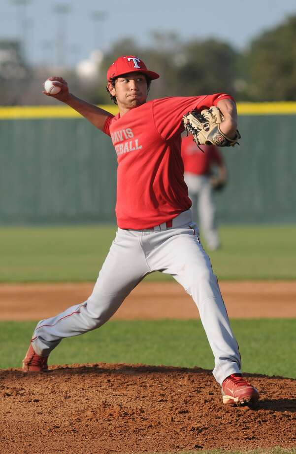 Fort Bend Travis pitcher Grant Khan and the Tigers are hoping to reclaim their playoff form this spring, but first turn their attention to the Centex Tournament in Austin this weekend. Photo: Jerry Baker, Freelance