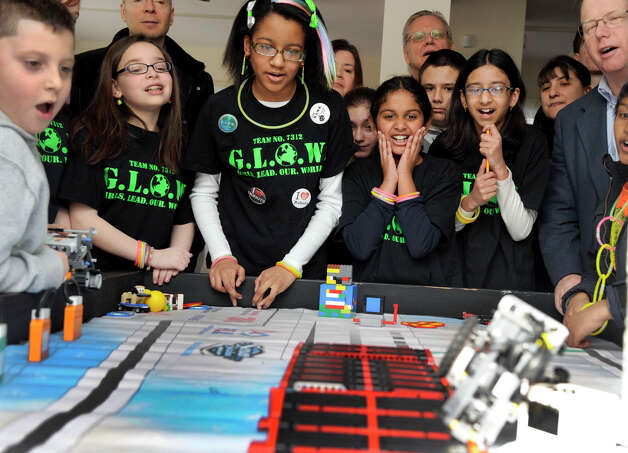 Members from the G.L.O.W. team demonstrate their Lego project for family and friends as well as Danbury Mayor Mark Boughton, right, Monday, Feb. 18, 2013, at a party celebrating the end of a  successful year. The Lego teams are coached by parent Ellen Bell. Photo: Carol Kaliff