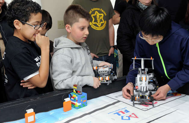 Members of a Lego group led by Danbury parent Ellen Bell celebrated a successful year with a party, Monday, Feb. 18, 2013. Photo: Carol Kaliff / The News-Times