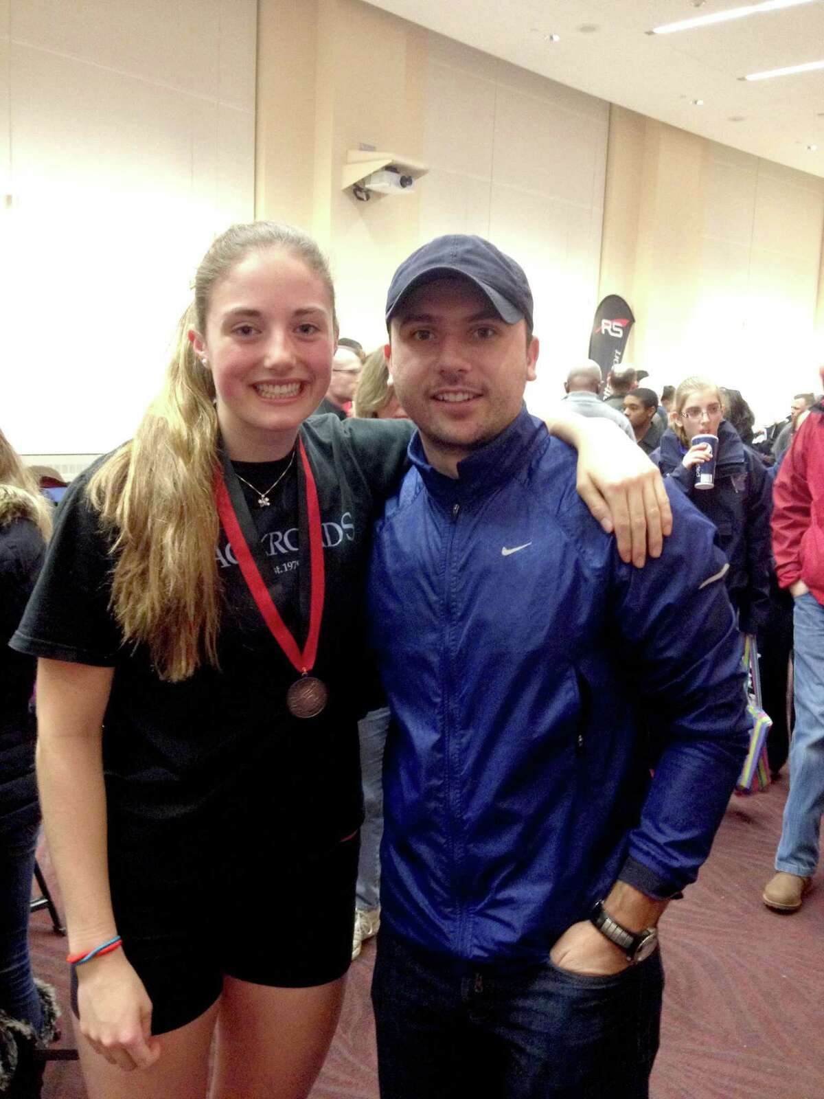 Melissa Curtis earned a bronze medal at the C.R.A.S.H.-B. World Indoor Rowing Championship, which was held recently in Boston. Curtis, seen here celebrating with Greenwich Crew Head Women's Coach Marko Serafimovski, finished third out of 230 athletes in the Junior Women's Openweight event. It was the first time in Greenwich Crew's history that a member of the junior team has placed in the top three in a C.R.A.S.H.-B. event, which draws athletes from around the world.