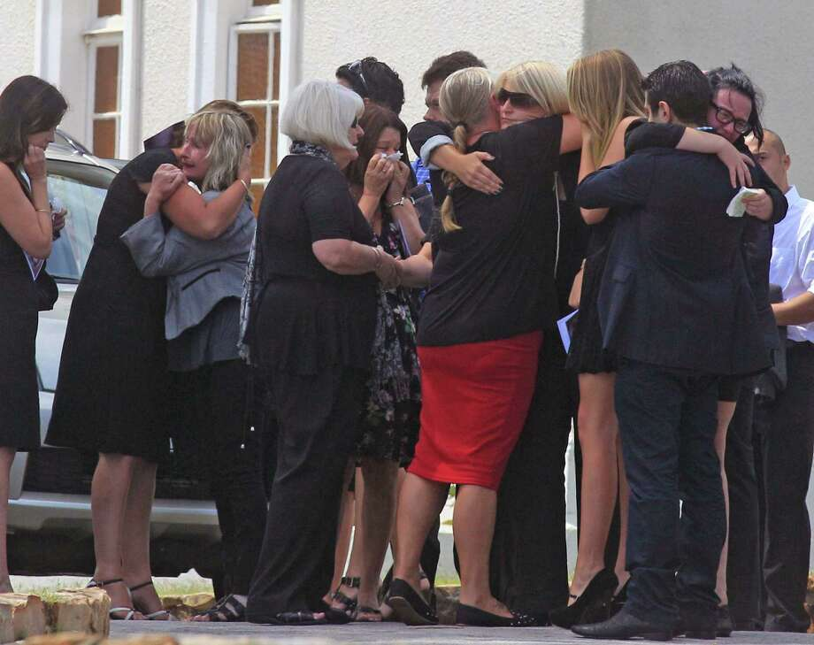 June Steenkamp, third left, the mother of  Reeva Steenkamp, greets people Tuesday after she and others attend Reeva's funeral in Port Elizabeth, South Africa. Photo: Schalk Van Zuydam, STF / AP