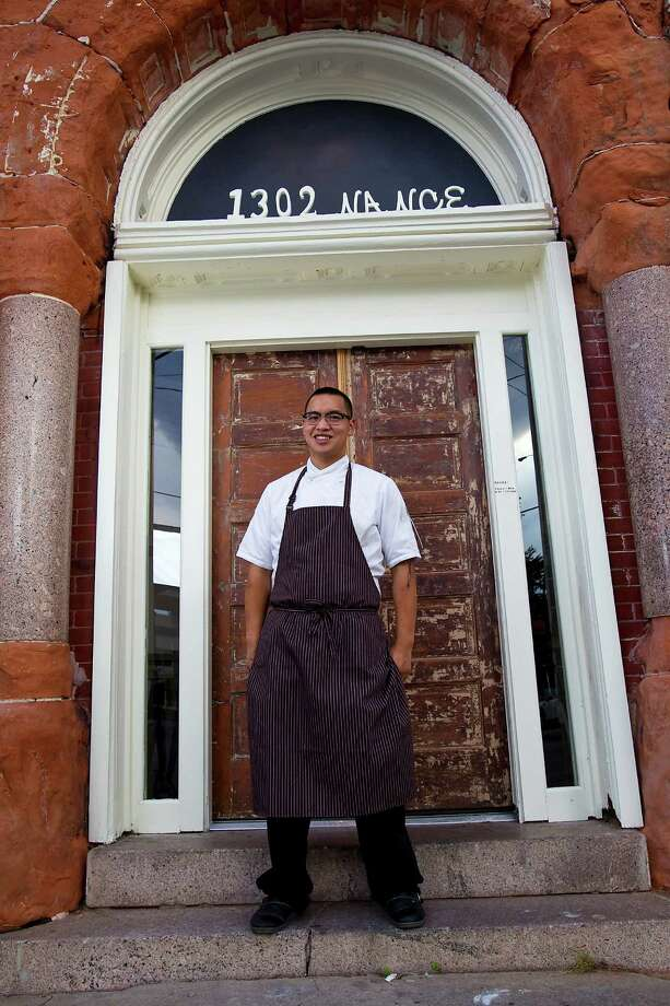 Oxheart's chef Justin Yu stands outside of the restaurant, Monday, May 14, 2012, in Houston, a new restaurant in the Warehouse District at 1302 Nance Street.  ( Karen Warren / Houston Chronicle ) Photo: Karen Warren, Staff / © 2012  Houston Chronicle
