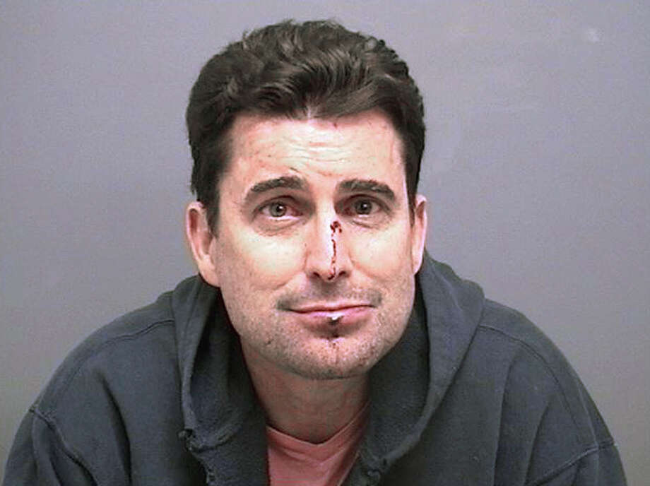 This booking photo released by the Darien, Conn., Police Department shows WCBS-TV anchor Rob Morrison arrested Sunday, Feb. 17, 2013, at his home in Darien. Police said he fought with his wife and then choked her at their home and threatened her even after he was arrested. Morrison was scheduled to be in court Tuesday on charges of strangulation, threatening and disorderly conduct.  (AP Photo/Darien Police Department)