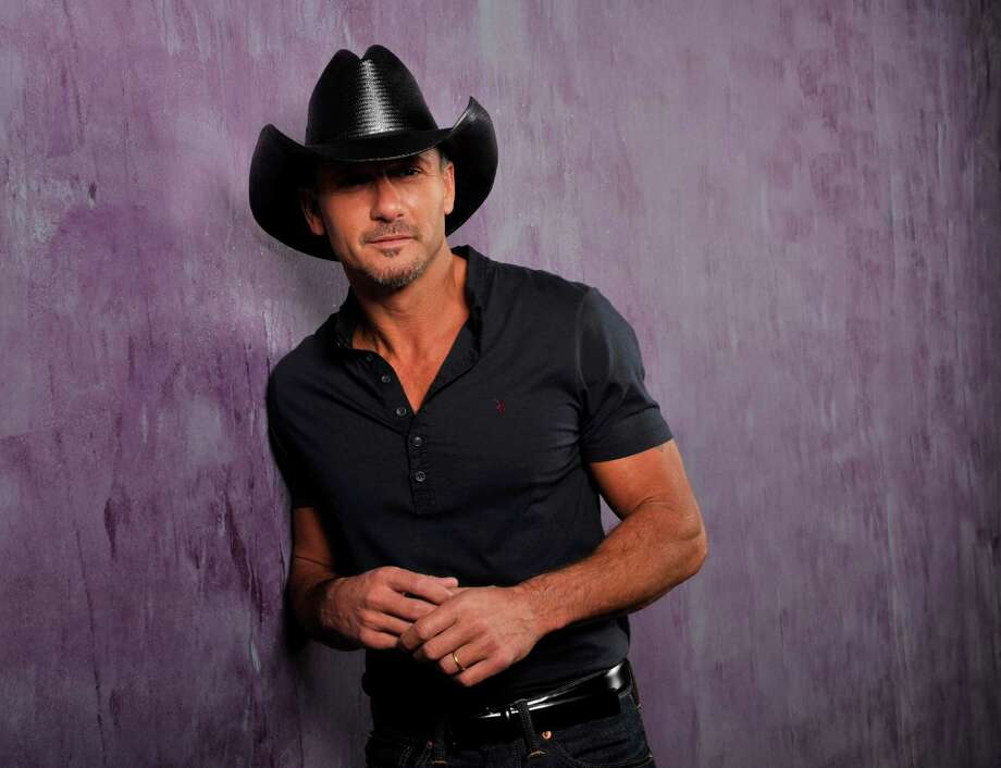 "This Jan. 15, 2013 photo shows country singer and actor Tim McGraw in Nashville, Tenn. His latest album, ""Two Lanes of Freedom,"" was released on Tuesday, Feb. 5.  The Tennessee Supreme Court has put an end to Curb Records' fight to keep Tim McGraw off another label, two weeks after he released his new album with Big Machine Records. (Photo by Donn Jones/Invision/AP, File) Photo: Donn Jones"