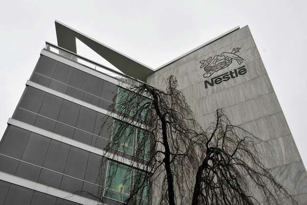 FILE - In this Feb. 19, 2010 file photo, an exterior view of the Nestle headquarters in Vevey, Switzerland. The world's biggest food and drinks maker Nestle SA has become the latest company to pull some of its products off European shelves after they were found to contain undeclared horse meat. The company, based in Vevey, Switzerland, said in a statement late Monday, Feb. 18, 2013 that it withdrew some of its beef pasta ready meals from sale after tests conducted two days earlier detected horse DNA. (AP Photo/Keystone, Dominic Favre, File) Photo: Dominic Favre