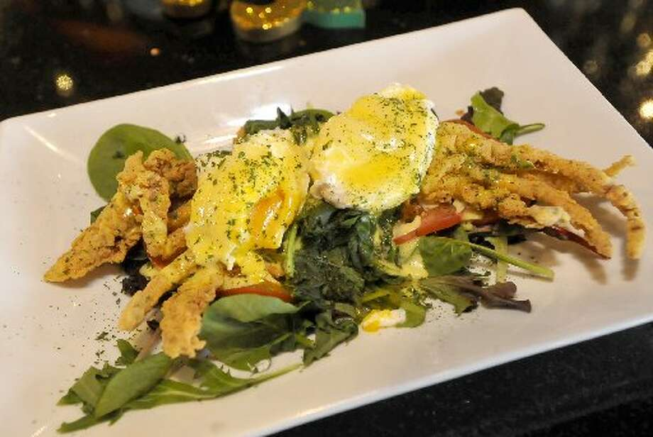 This is a brunch dish of soft shell crab and Eggs Benedict.