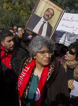 Basma Belaid, wive of slain opposition leader Chokri Belaid, attends a rally outside the constitutional parliament, Monday, Feb,11, 2013. An agreement is imminent on a new national unity government for Tunisia to resolve the simmering political crisis brought on by the assassination of an opposition politician, the leader of the powerful Islamist party told the Associated Press Monday. (AP Photo /Amine Landoulsi)