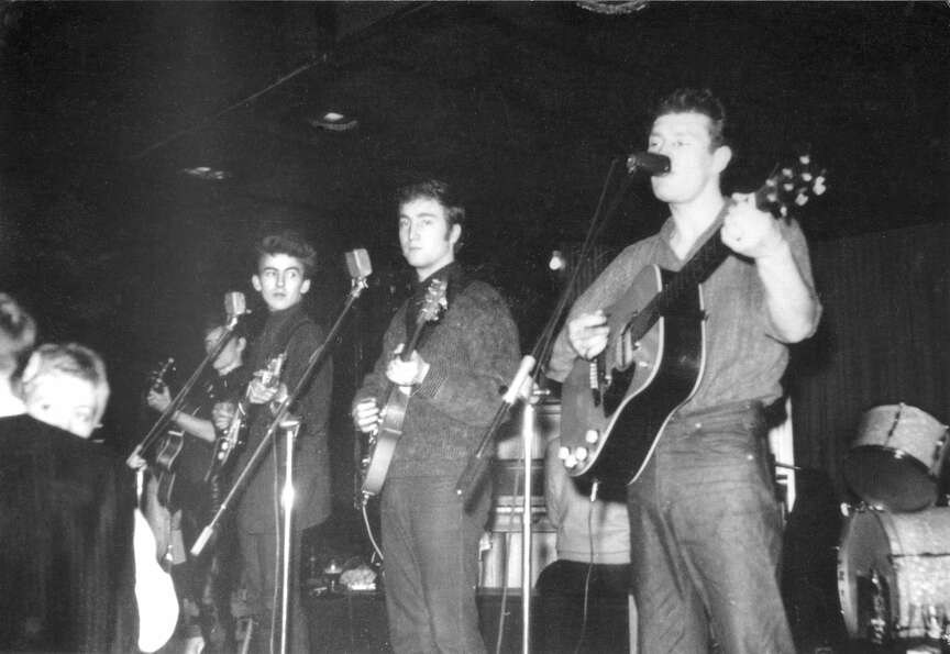 Tony Sheridan, right, with John Lennon, center, and George Harrison in Germany, about 1960.