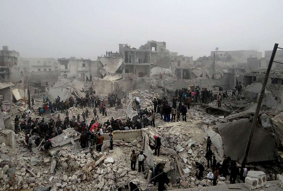 A handout picture released by Syria's opposition-run Aleppo Media Centre (AMC) shows Syrians inspecting destruction following an apparent surface-to-surface missile strike on the northern Syrian city of Aleppo on February 19, 2013. Six children were among at least 19 people killed in an apparent surface-to-surface missile strike on the northern Syrian city of Aleppo late on February 18, the Syrian Observatory for Human Rights said.  Photo: Ho, AFP/Getty Images