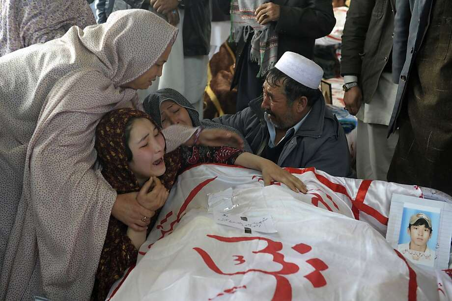 A Pakistani woman is comforted by other relatives while grieving over the body of her brother Mohammed Ali, who was killed in Saturday's bombing, in Quetta, Pakistan, Tuesday, Feb. 19, 2013. Pakistan on Tuesday ordered an operation in the southwestern city of Quetta following a weekend bombing targeting minority Shiite Muslims that killed scores of people there, and sacked the top police officer in the surrounding Baluchistan province as victims of the bombing refuse to bury their dead in protest.  Photo: Arshad Butt, Associated Press
