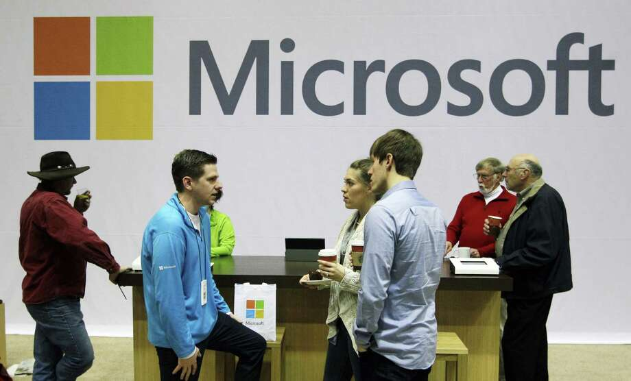 FILE - In this Nov. 28, 2012, file photo, Microsoft Corp. retail store employees and guests mingle at a pop-up Microsoft Store during Microsoft's annual meeting of shareholders, in Bellevue, Wash. Longtime users of Hotmail, MSN and other Microsoft email services will start noticing a big change: When they sign in to check messages, they'll be sent to a new service called Outlook.com. (AP Photo/Ted S. Warren,File) Photo: Ted S. Warren