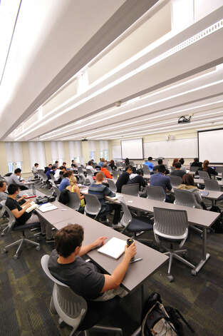 "University at Albany classroom shows ""barrel vault"" lights, which provide muted, indirect illumination. The original fixtures were retrofitted to accept modern, energy-efficient lighting.  (New York Power Authority photo)"