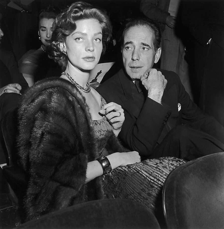 """Married American actors Lauren Bacall and Humphrey Bogart wear formal evening clothes while seated at the Academy Awards, RKO Pantages Theater, Los Angeles. Bogart won for Best Actor in director John Huston's film, """"The African Queen."""" Photo: Murray Garrett"""