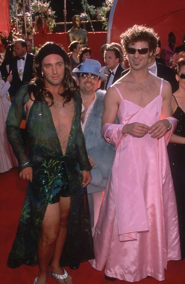 "2000: ""South Park"" creators Matt Stone (left) and Trey Parker pay homage to Jennifer Lopez's green Versace Grammy Award dress Gwyneth Paltrow's pink Ralph Lauren gown from the 1999 Oscars.  Photo: Paul Fenton"