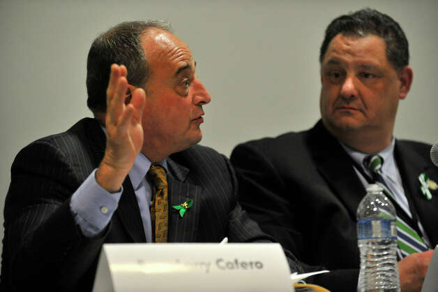 Rep. Larry Cafero, left, answers a question as Rep. Mitch Bolinsky listens during the Newtown Action Alliance-organized hearing on gun violence at Newtown High School on Tuesday, Feb. 19, 2013. Photo: Jason Rearick / The Advocate