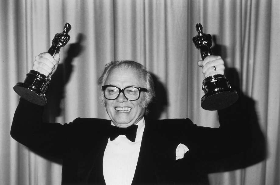 "Richard Attenborough displays the Oscars for best director and best picture for the biopic ""Gandhi."" Photo: Fotos International"