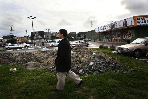 People's Community Market CEO Brahm Ahmadi walks on a vacant lot at West Grand Avenue and Market Street in West Oakland where a supermarket is planned. Photo: Liz Hafalia, The Chronicle
