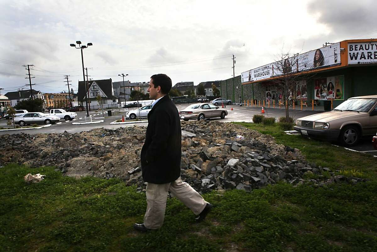 People's Grocery former director Brahm Ahmadi walks on a vacant lot at West Grand Shopping center in Oakland, Calif., where he plans to have his store site on Monday, February 18, 2013. He used to live a block away from the site and says the closest grocery store is 1.5 miles away.