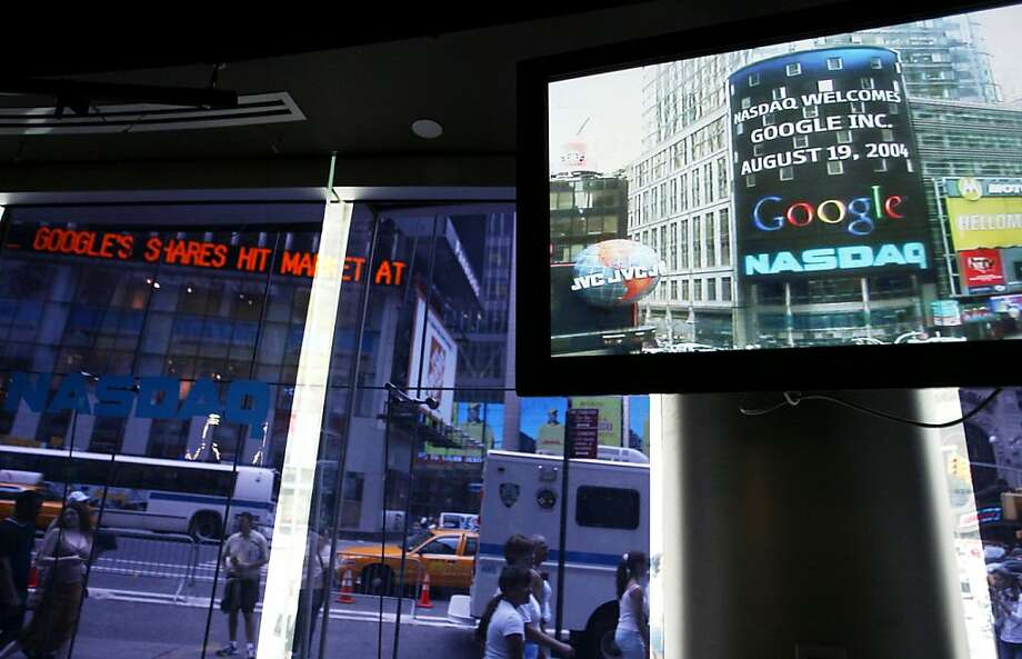 Google's logo appears on a screen at Nasdaq in 2004 when shares topped $100; now they're over $800. Photo: Chris Hondros, Getty Images