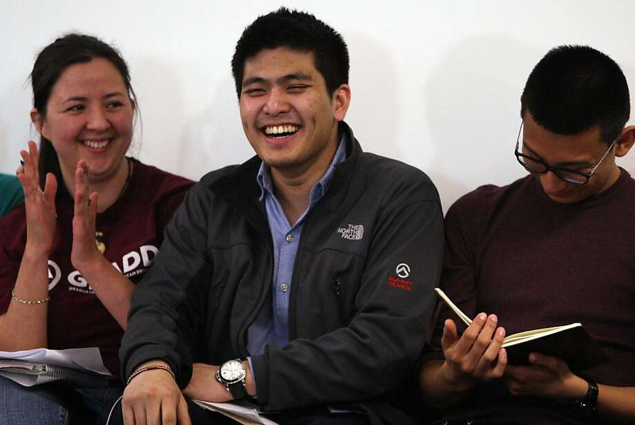 "Jirayut ""New"" Latthivongskorn (center) is joined by Nalleli Sandoval (left) and Angel Ku at a forum at UC Berkeley's Multicultural Community Center. Latthivongskorn is a Dreamer who is blocked from participating in the Affordable Care Act. Photo: Jessica Olthof, The Chronicle"