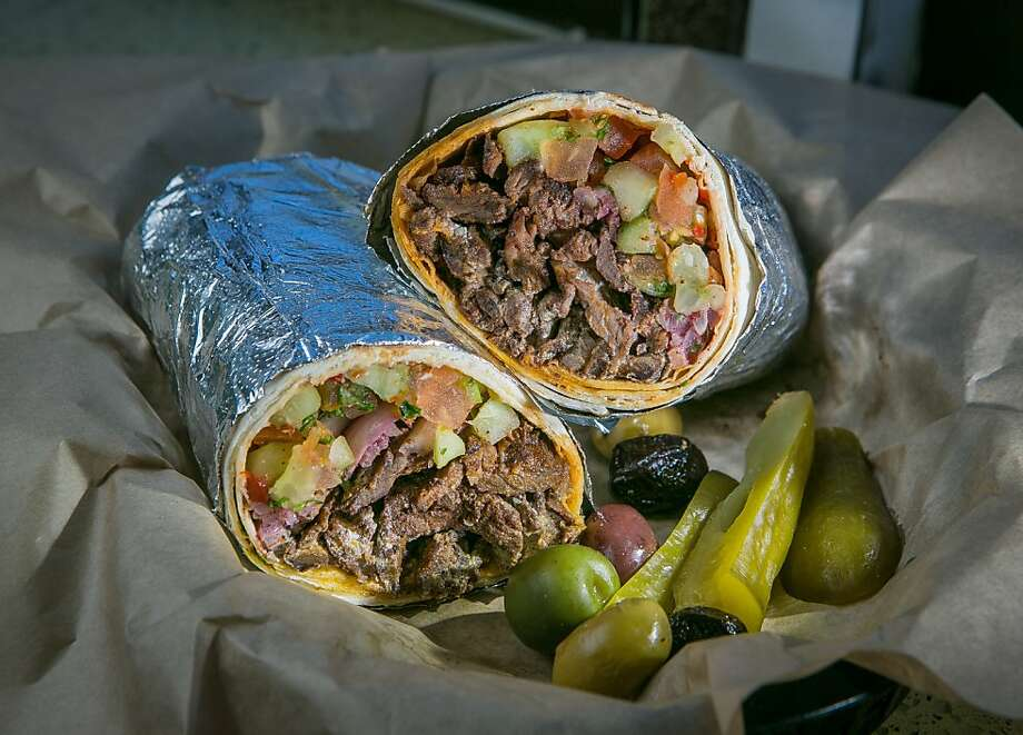 The lamb shawerma wrap is packed tightly in toasted lavash. Photo: John Storey