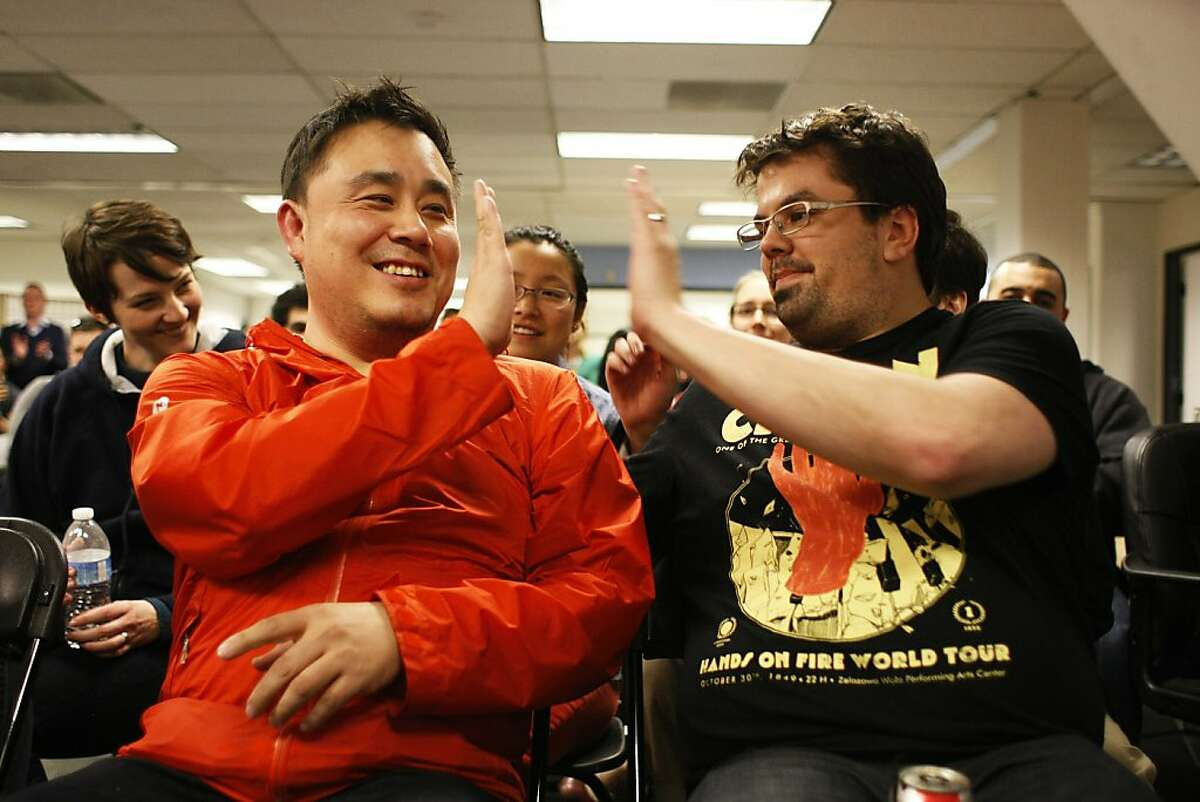 Members of Splendidly Dan Cheung, left, and Eric Goldberg exchange high fives after they were declared winners of the Startup Weekend on Sunday, Feb. 17. The Startup Weekend featured companies focused on the intersection of fashion and technology whose apps were looked at by judges.