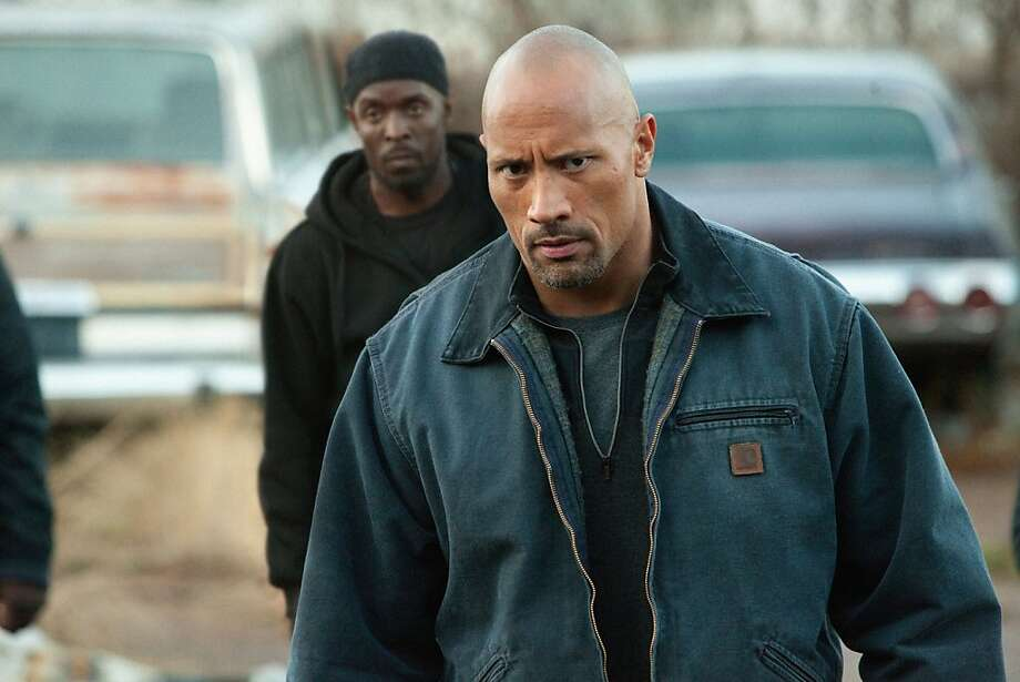 "Dwayne ""The Rock"" Johnson stars in as a father who goes undercover for the DEA to clear the name of his wrongfully accused son. ""Snitch"" opens Friday. Click here for more information.  Photo: Steve Dietl, Summit Entertainment"