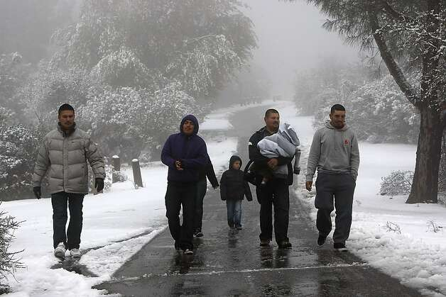 People walk through a blizzard on Mount Diablo State Park on February 19, 2013 in Clayton, Calif. Heavy rains and cold temperatures around the Bay Area brought snow to the higher elevation of Mount Diablo SP. Photo: Sean Havey, The Chronicle