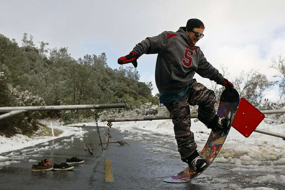 Concord resident, Shane White, plays around on his snowboard after  the top of Mount Diablo State Park was blanketed with snow on February 19, 2013 in Clayton, Calif. Heavy rains and cold temperatures around the Bay Area brought snow on the higher elevation of Mount Diablo SP. Photo: Sean Havey, The Chronicle