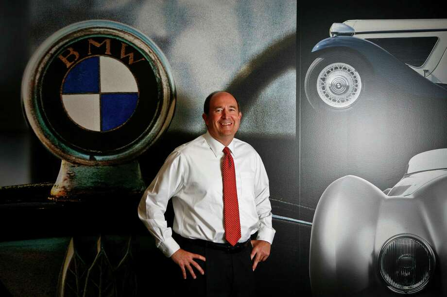 Earl Hesterberg, CEO of Group 1, stands in the Advantage BMW showroom Thursday, April 29, 2010, in Houston.   Photos for Chron 100 special section.  ( Michael Paulsen / Houston Chronicle ) Photo: Michael Paulsen, Staff / Houston Chronicle