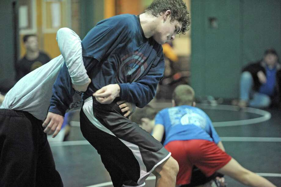 Burnt Hills High School wrestler Jake Ashcraft, right, runs through drills at Shenendehowa High School on Tuesday, Feb. 19, 2013 in Clifton Park, NY.  Some of the area wrestlers who will compete in the state tournament were at  Shenendehowa to practice. (Paul Buckowski / Times Union) Photo: Paul Buckowski  / 00021208A