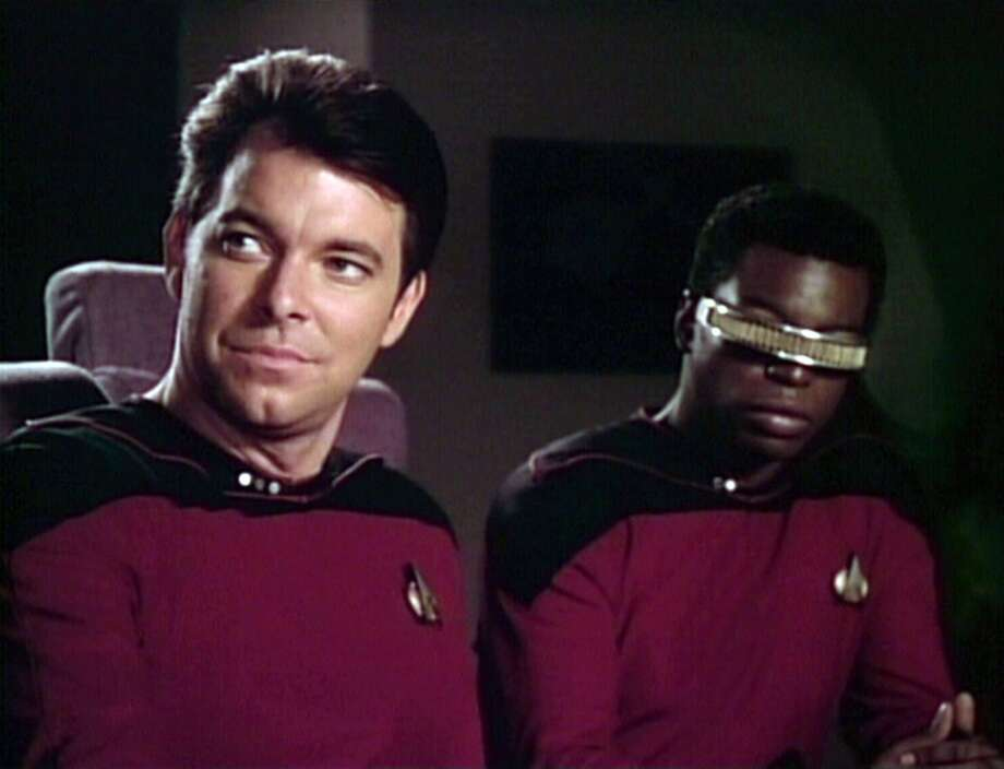 Jonathan Frakes (left) as Commander William T. Riker and LeVar Burton as Lt. Cmdr. Geordi La Forge in a 1988 episode of TNG. Burton was one of the show's few actors already familiar to TV audiences.