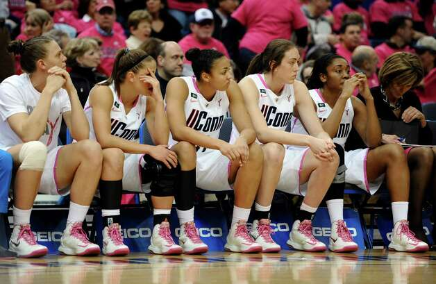 Connecticut players, from left, Heather Buck, Caroline Doty, Kiah Stokes, Breanna Stewart, Morgan Tuck and associate head coach Chris Daily watch play late the second half of an NCAA college basketball game against Baylor in Hartford, Conn., Monday, Feb. 18, 2013. Baylor won 76-70. (AP Photo/Jessica Hill) Photo: Jessica Hill, Associated Press / FR125654 AP