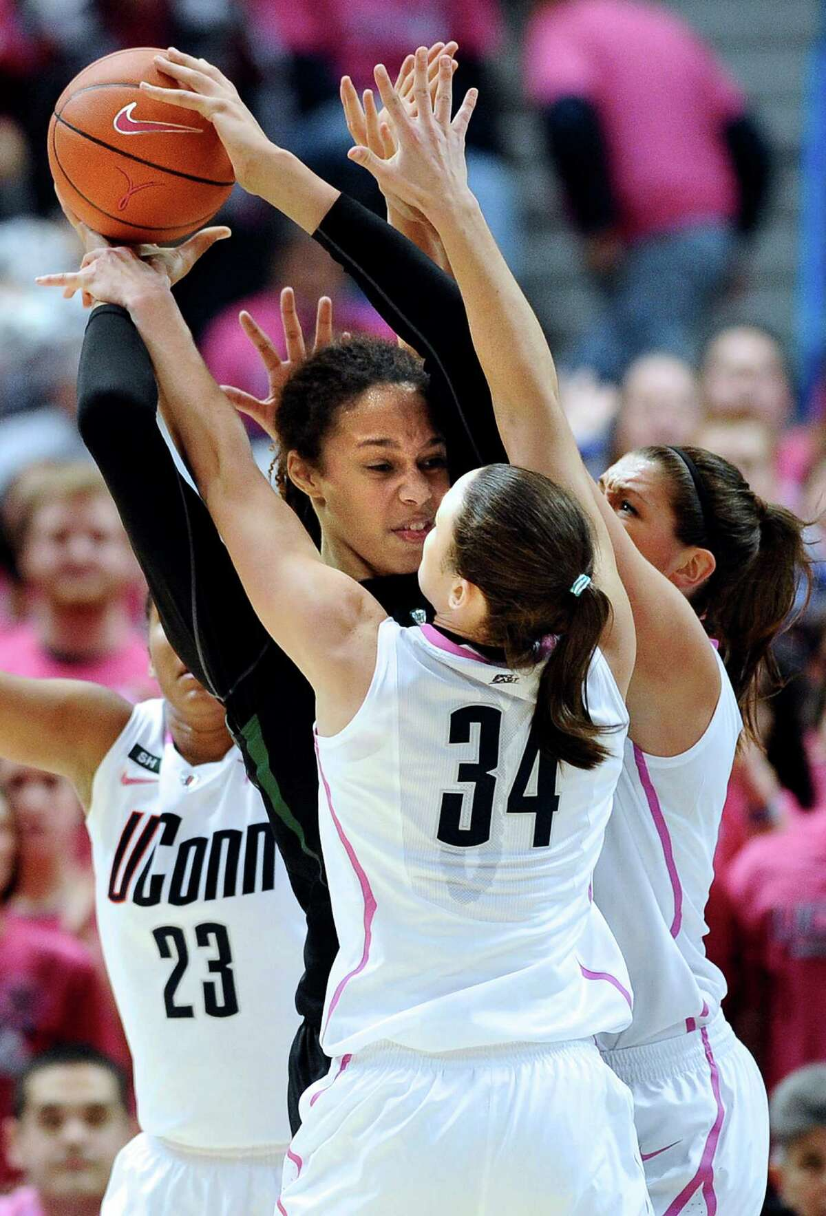 Connecticut's Kelly Faris (34), Stefanie Dolson, right, and Kaleena Mosqueda-Lewis (23) pressure Baylor's Brittney Griner, center, during the second half of an NCAA college basketball game in Hartford, Conn., Monday, Feb. 18, 2013. (AP Photo/Jessica Hill)