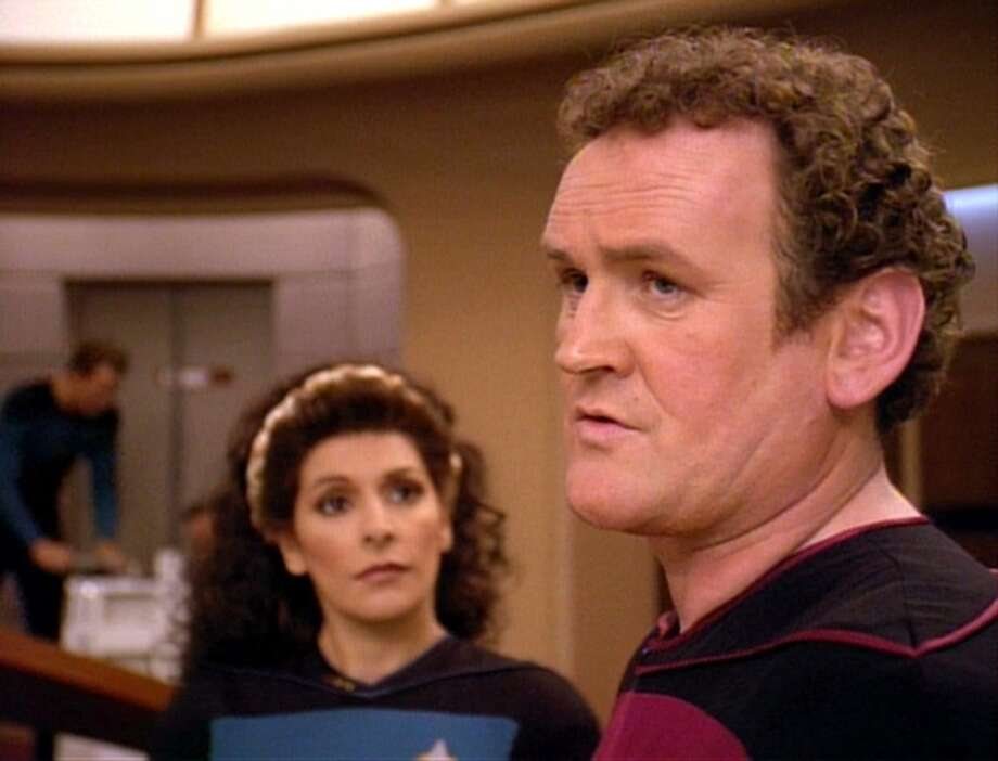Colm Meaney (right) played Chief Miles O'Brien. He's pictured in this 1994 scene with Marina Sirtis as Deanna Troi.