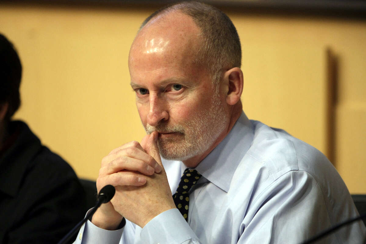 A pensive Seattle City Council member Tim Burgess. He has avoided posturing, and written such serious legislation as the Families and Education Levy while colleagues' efforts have often gone to symbolic resolutions.  He was a police officer and successful businessman before winning a Council seat in 2007.