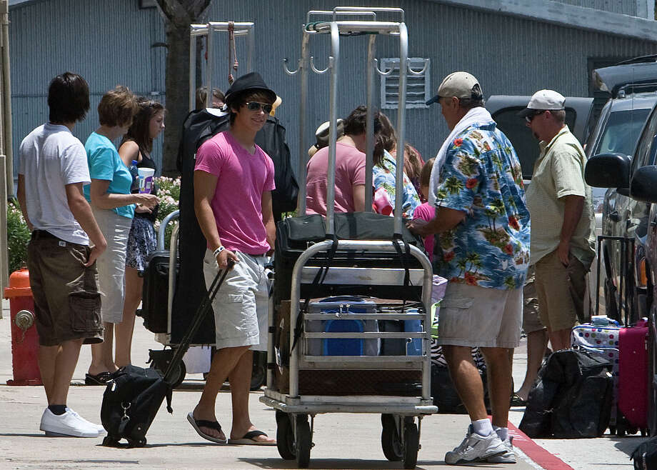 Scenes like this in 2010 at a Carnival ship at the Galveston cruise ship terminal will be scarce after the Triumph's problems. Photo: James Nielsen, Staff / Houston Chronicle