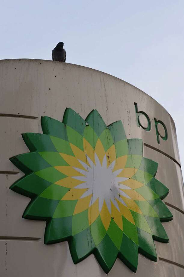 The government accused BP of gross negligence, and previously calculated that 4.9 million barrels of oil were discharged by the company's undersea well off Louisiana. BP said the oil flow total is overstated by at least 20 percent. Photo: Carl Court / AFP / Getty Images