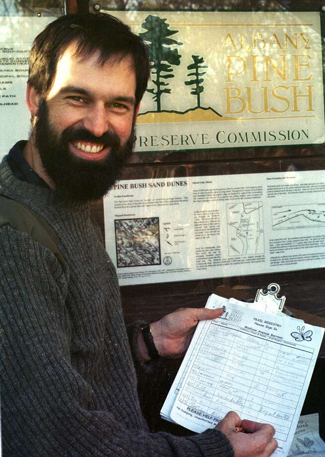 Times Union Staff Photograph by Fred Lebrun:  PineBush Commision  executive director Willie Janeway by a trailhead  to one of the 20 miles of trail in Albany County's pine bush. The commission adopted a controversial new set of rules and regulations this week stressing increased opportunities for multiple use, from horseback riding to hunting to trapping. The new rules still require the approval of Department of Environmental Conservation commissioner John Cahill, but that is expected. Photo: FRED LEBRUN / ALBANY TIMES UNION