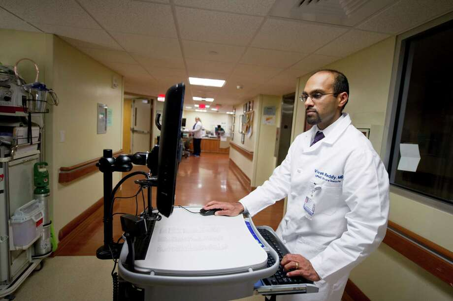 Dr. Vivek Reddy, a neurologist who has helped organize the electronic medical records system within the University of Pittsburgh Medical Center Health System, at a hospital in Pittsburgh, Feb. 7, 2013. While proponents say new record-keeping technologies will one day reduce costs and improve care, profits and sales are soaring now across the records industry. (Jeff Swensen/The New York Times) Photo: JEFF SWENSEN / NYTNS