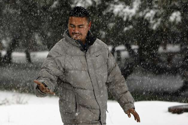 Yovanhi Hernandez, of Concord, walks through heavy snowfall on Mount Diablo State Park on February 19, 2013 in Clayton, Calif. Heavy rains and cold temperatures around the Bay Area brought snow to the higher elevation of Mount Diablo SP. Photo: Sean Havey, The Chronicle