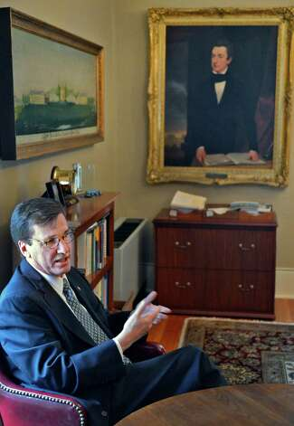 Union College president Stephen Ainlay discusses William Henry Seward, a member of Union's Class of 1820, beneath an early portrait of Seward in Ainlay's office on the Union campus in Schenectady Tuesday Feb. 19, 2013.   (John Carl D'Annibale / Times Union) Photo: John Carl D'Annibale / 00021213A