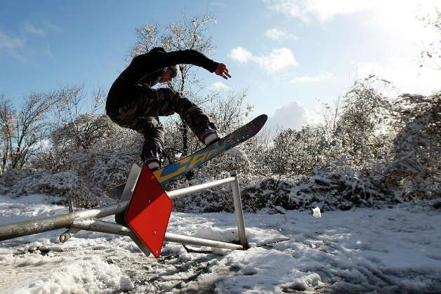 Concord resident, Woody Wilcox jumps over a road barricade on his snowboard at Mount Diablo State Park on February 19, 2013 in Clayton, Calif. Heavy rains and cold temperatures around the Bay Area meant snow on the higher elevation of Mount Diablo SP. Photo: Sean Havey, The Chronicle