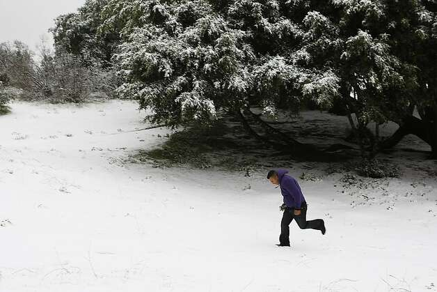 Luciano Lopez, of Concord, runs through the snow on Mount Diablo State Park on February 19, 2013 in Clayton, Calif. Heavy rains and cold temperatures around the Bay Area brought snow to the higher elevation of Mount Diablo SP. Photo: Sean Havey, The Chronicle