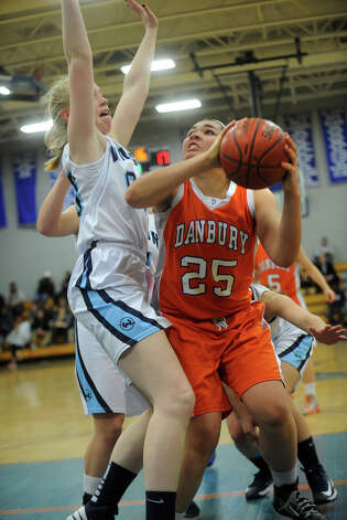 Danbury's Kayla Handberry looks to score inside against Wilton's Erica Meyer during the FCIAC girls' basketball semi-finals at Ludlowe High School in Fairfield on Tuesday, February 19, 2013. Photo: Brian A. Pounds / Connecticut Post