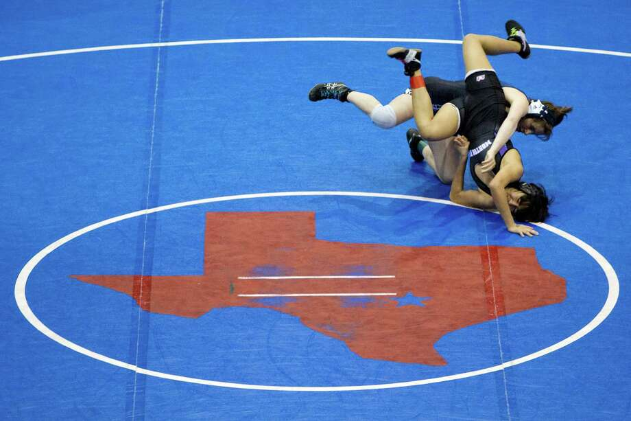 Morton Ranch's Kristin Navarrete (bottom), wrestling Bryan's Laura Hawk, was among 89 area qualifiers for the 2012 state meet. The number is up to 183 this year. Photo: Smiley N. Pool, Staff / © 2012  Houston Chronicle