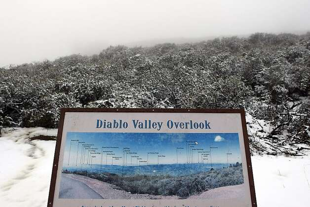 The Diablo Valley Overlook is obstructed by cloud cover at Mount Diablo State Park on February 19, 2013 in Clayton, Calif. Heavy rains and cold temperatures around the Bay Area meant snow on the higher elevation of Mount Diablo SP. Photo: Sean Havey, The Chronicle