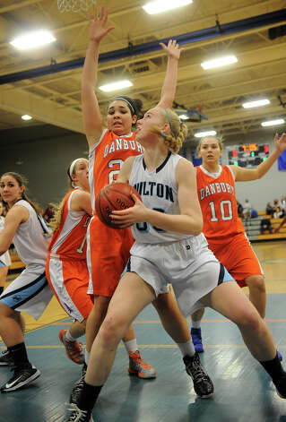Wilton's Erica Meyer looks to score inside against Danbury's Kayla Handberry during the FCIAC girls' basketball semi-finals at Ludlowe High School in Fairfield on Tuesday, February 19, 2013. Photo: Brian A. Pounds / Connecticut Post