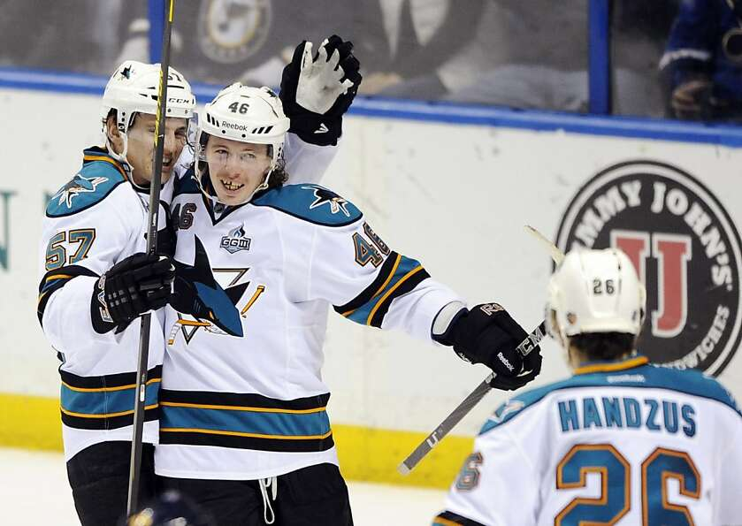 Tim Kennedy (center) celebrates the goal that turned out to be the game-winner with Tommy Wingels an
