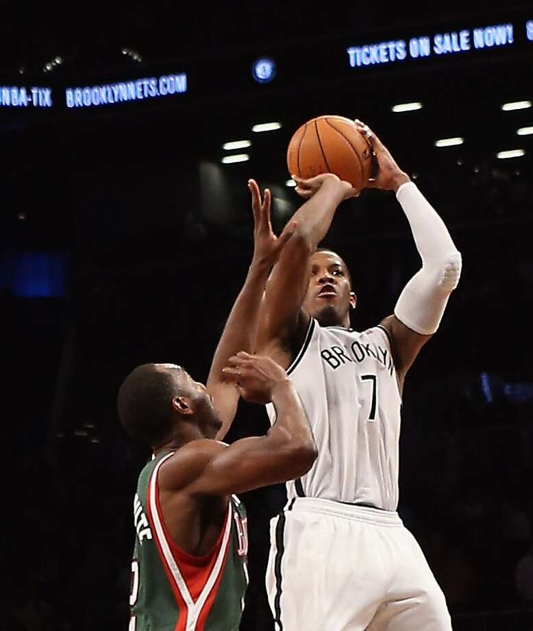 Brooklyn's Joe Johnson rises for what would become his game-winning basket in overtime. Photo: Bruce Bennett, Getty Images